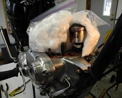 Triumph pistons packed in ice for grudgeon pin removal